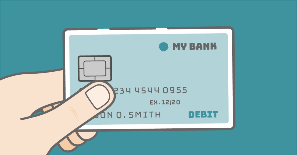 Hand holding a debit card over a blue background